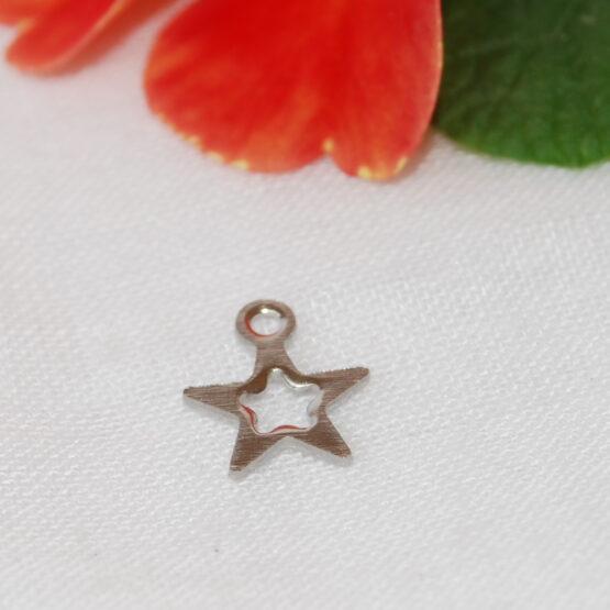Nemesacél csillag alakú fityegő charm